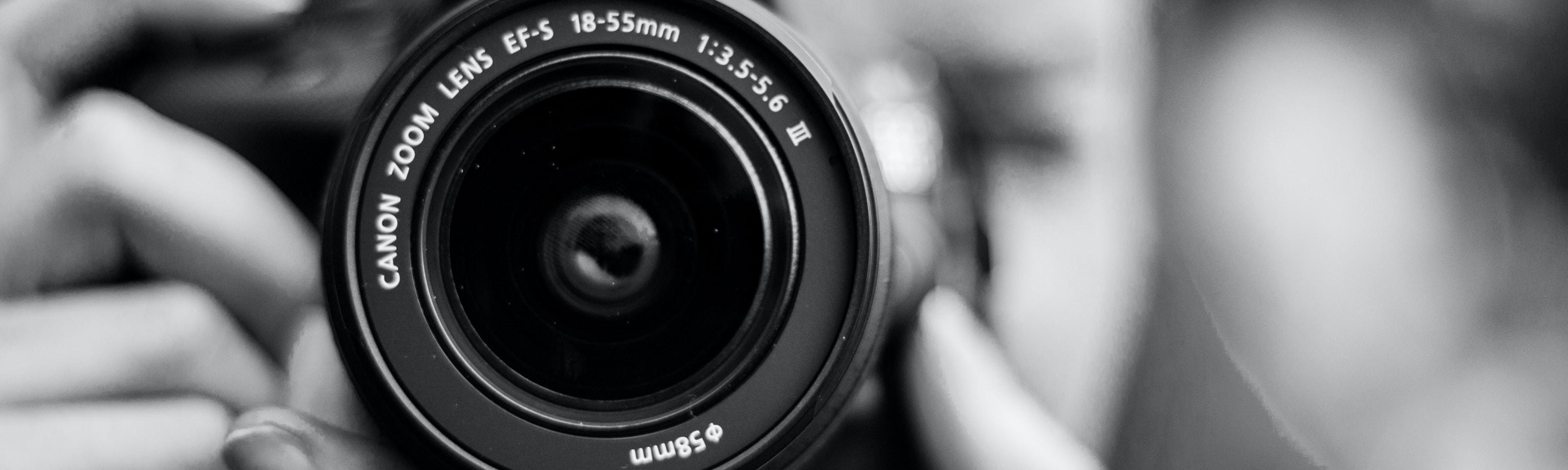 Black and white photo of Canon camera lens
